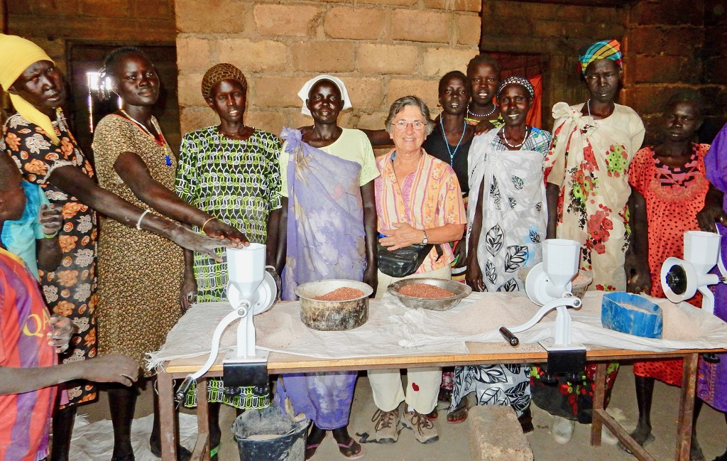 Women celebrate gift of hand grain grinders from Dr. Ann